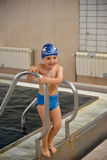 Little boy having fun at the swimming pool Stock Photo