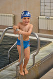 Little boy having fun at the swimming pool Royalty Free Stock Photos