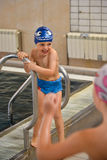 Little boy having fun at the swimming pool Royalty Free Stock Photography