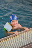 Little boy having fun at the swimming pool Stock Photos