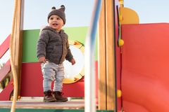Toddler having fun. Little boy having fun on a toddler park stock photo