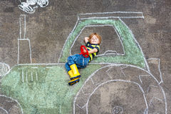 Little boy having fun with tractor picture drawing Stock Images