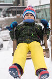 Little boy having fun on winter day Stock Photo