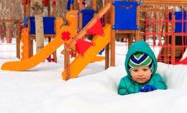 Little boy having fun in winter playground Royalty Free Stock Photo