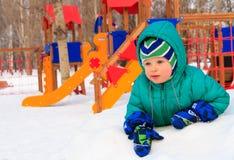 Little boy having fun in winter playground Stock Photo