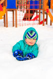 Little boy having fun in winter playground Stock Images