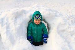 Little boy having fun in winter snow Stock Image