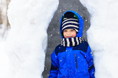Little boy having fun in winter snow Stock Photography