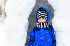 Little boy having fun in winter snow cave Royalty Free Stock Photos