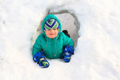 Little boy having fun in winter snow Stock Images