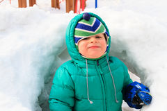 Little boy having fun in winter snow Royalty Free Stock Photo