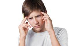 Little boy having a headache. Portrait of little boy having a headache isolated on white Royalty Free Stock Photos