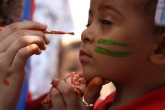 Little boy having his face painted Kids having fun playing Stock Images