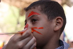 Little boy having his face painted Kids having fun playing Stock Image