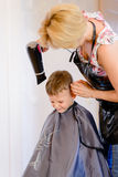 Little boy having his hair blow dried Royalty Free Stock Photo