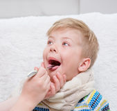 Little boy having his throat examined by health professional Royalty Free Stock Images