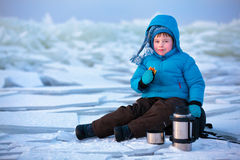 Little boy having a picnic on winter vacation Stock Photos