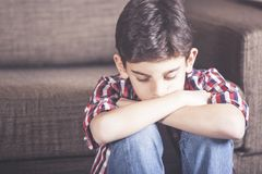 Little boy having problems. Sad kid lost in his thoughts. Depression concept royalty free stock image