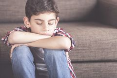 Little boy having problems. Unhappy young boy in despair. Depression concept Stock Images