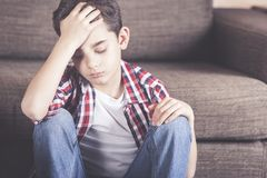 Little boy having problems. Unhappy young boy in despair. Depression concept royalty free stock photo