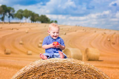 Little boy on a hay bale Royalty Free Stock Photography