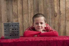 Little boy,  head resting on his arms Stock Images
