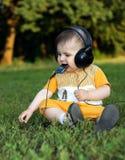 Little boy with headphones Royalty Free Stock Photos