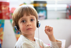 Little boy with headphones Stock Images