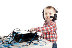 Little boy with headphones Stock Photos