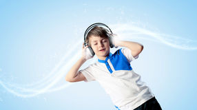 Little boy in headphones Stock Photo