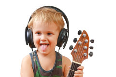 Little boy with headphones and guitar Stock Image