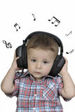 Little boy with headphones listening to music Royalty Free Stock Image