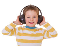 Little boy in headphones Stock Photos