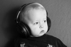 A little boy with headphones looking Royalty Free Stock Photography