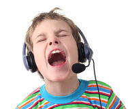 Little boy with headphones and microphone singing Stock Image