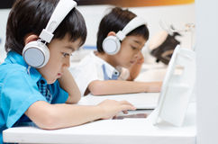 Little boy with headset in classroom Stock Photography