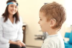 Little boy with hearing aid in otolaryngologist's office royalty free stock photography