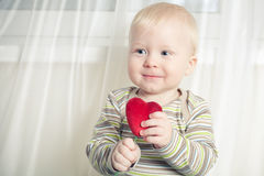 Little boy with heart Stock Images