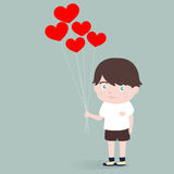Little boy with heart balloons Stock Photo