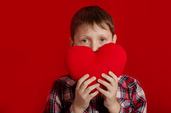 Little boy with a heart of toy and gift box Royalty Free Stock Photo