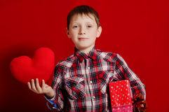 Little boy with a heart of toy and gift box Royalty Free Stock Photography