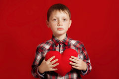 Little boy with a heart of toy Stock Photos