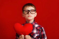 Little boy with a heart of toy Royalty Free Stock Images