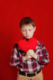 Little boy with a heart of toy Stock Photography