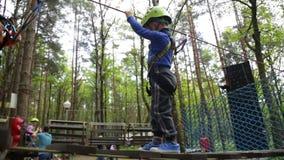 Little boy in helmet walks by pendant path stock video