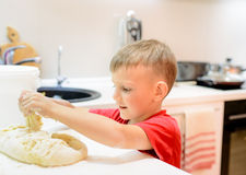 Little boy helping with the baking Royalty Free Stock Image