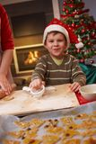 Little boy helping at christmas Stock Images