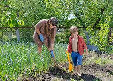 Little boy helping his mother in the garden Royalty Free Stock Photos