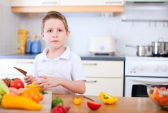 Little boy helping at kitchen Royalty Free Stock Photo