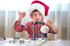 Little boy helping at kitchen with baking cookies Royalty Free Stock Image
